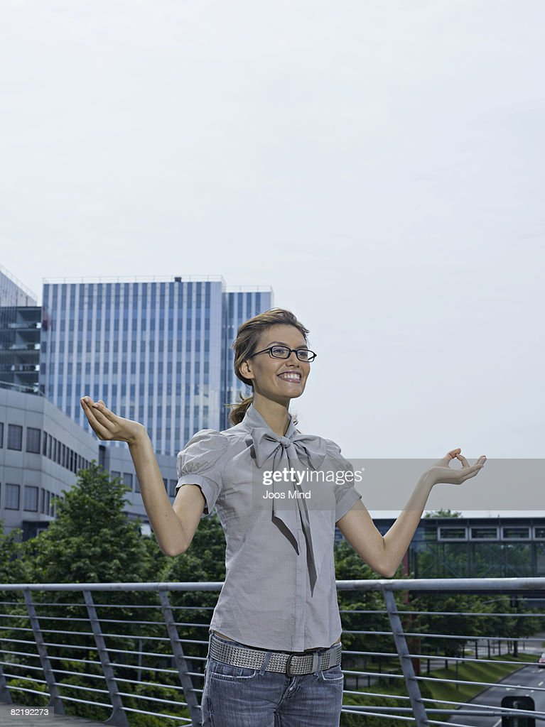 young businesswoman doing yoga exercise outdoors : Stock Photo