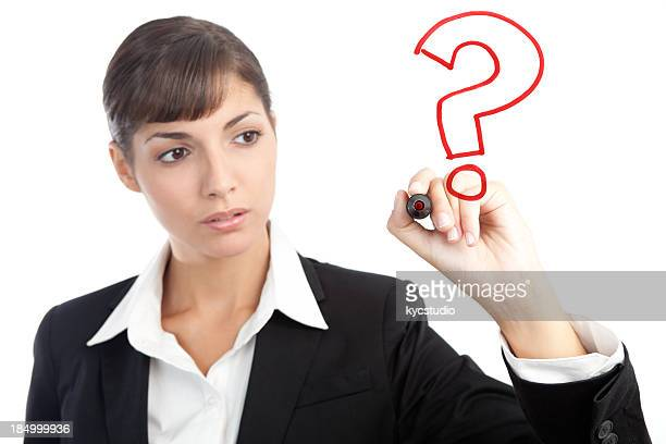 Young Businesswoman Drawing a Question Mark