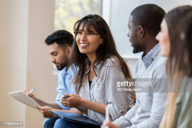 young businesswoman enjoys employee training class - employee stock pictures, royalty-free photos & images