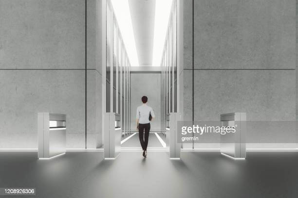 young businesswoman entering office building interior - building entrance stock pictures, royalty-free photos & images