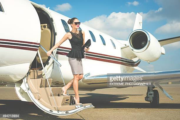 Young businesswoman exiting private aeroplane