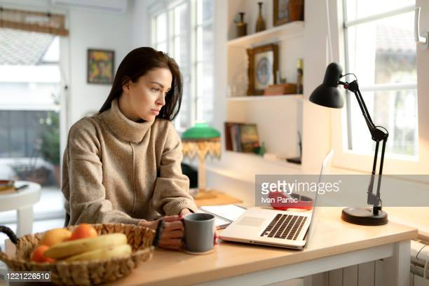 young businesswoman feeling stressed while working from home - one young woman only stock pictures, royalty-free photos & images