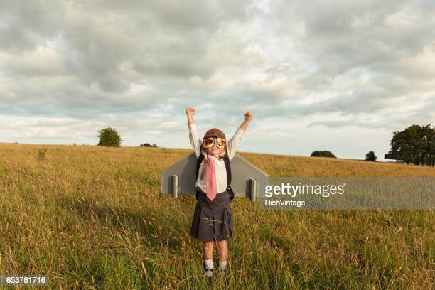 young businesswoman flies jet pack into the sky - attitude stock pictures, royalty-free photos & images