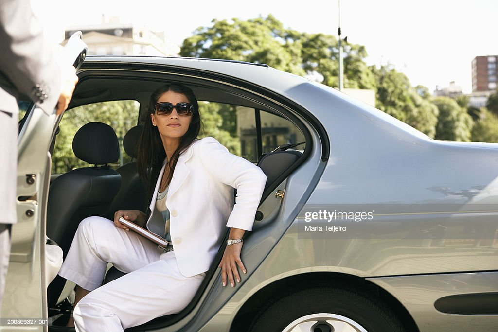 young businesswoman getting out of back seat of car stock photo getty images. Black Bedroom Furniture Sets. Home Design Ideas