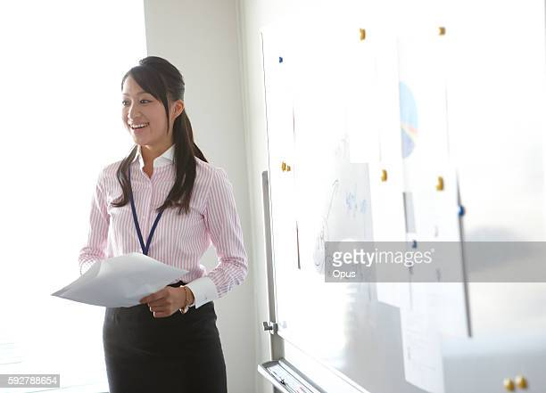 Young Businesswoman Giving Presentation