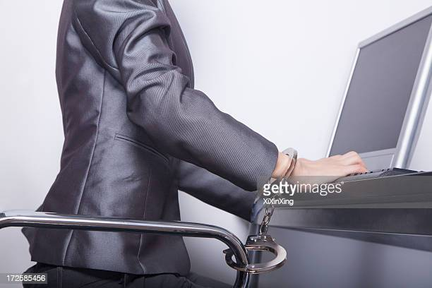 young businesswoman handcuffed to her office chair - caught cheating stock pictures, royalty-free photos & images