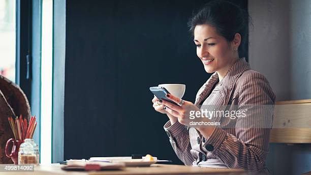 Young businesswoman having a coffee