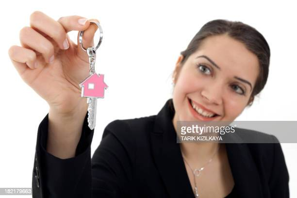 Young businesswoman holding a house key