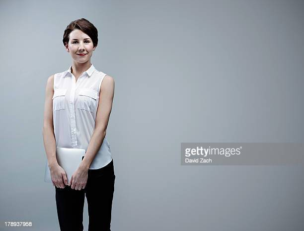 young businesswoman holding digital tablet - sleeveless stock pictures, royalty-free photos & images