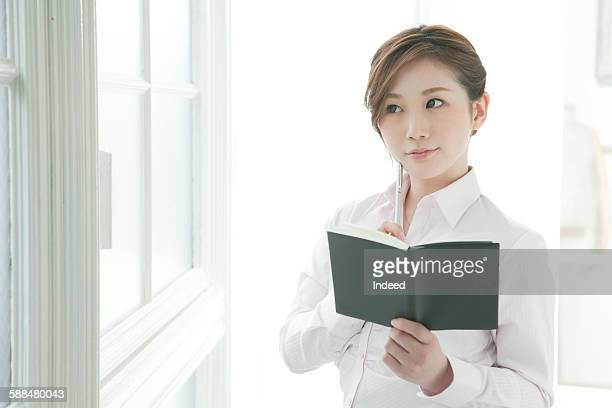 Young businesswoman holding notepad