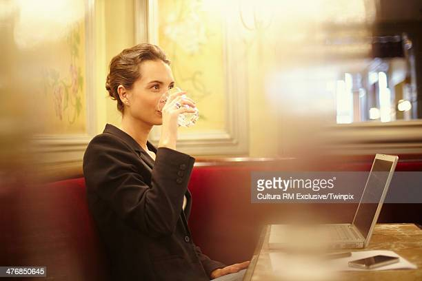 Young businesswoman in cafe with laptop
