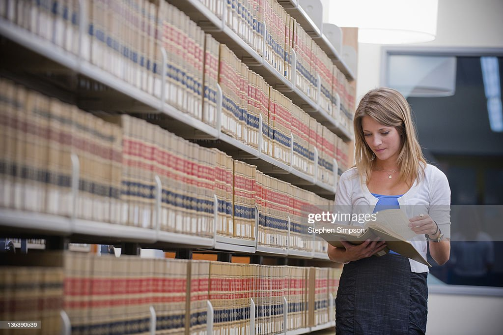 young businesswoman in law library : Stock Photo