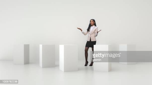 young businesswoman in office studio - cube shape stock pictures, royalty-free photos & images