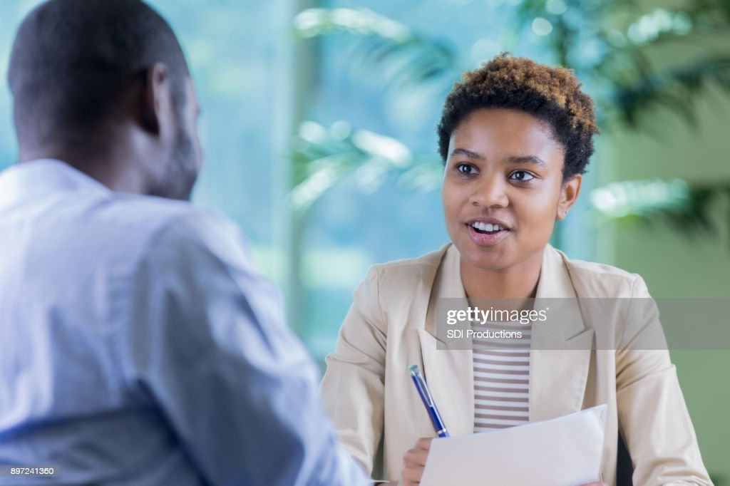 Young businesswoman interviews job candidate : Stock Photo