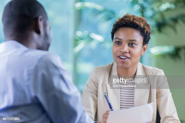 Young businesswoman interviews job candidate