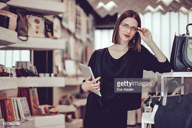 Young businesswoman is working in her store