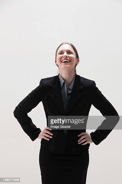Young businesswoman laughing, studio shot