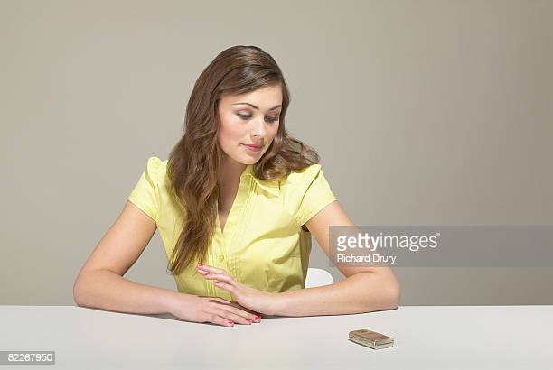 young businesswoman looking at mobile phone - richard drury stock pictures, royalty-free photos & images