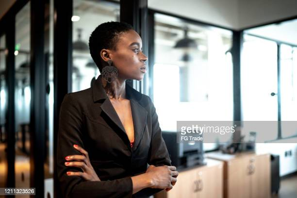 young businesswoman looking away - business contemplation stock pictures, royalty-free photos & images