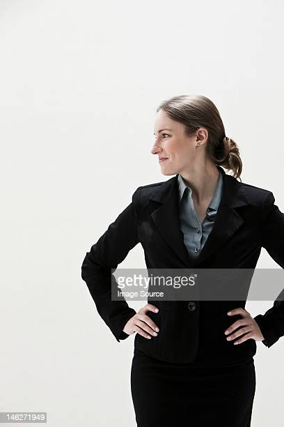 young businesswoman looking away, studio shot - giacca da abito foto e immagini stock