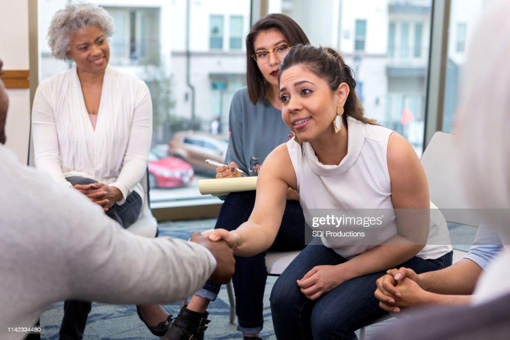 Young businesswoman meets new client : Stock Photo
