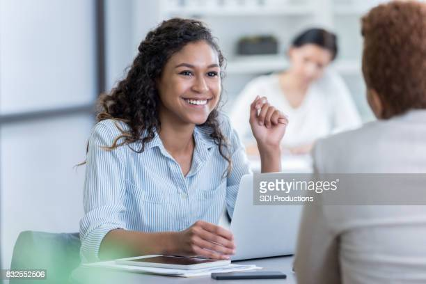 Young businesswoman meets with client