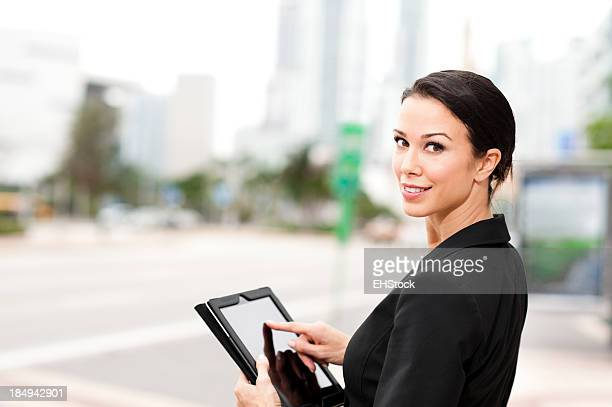 Young Businesswoman on Downtown Sidewalk