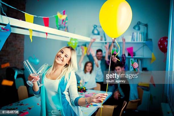 Young businesswoman partying