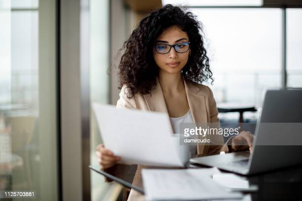 young businesswoman preparing for business meeting - preparation stock pictures, royalty-free photos & images