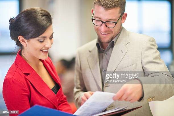 Young businesswoman presenting ideas to colleague