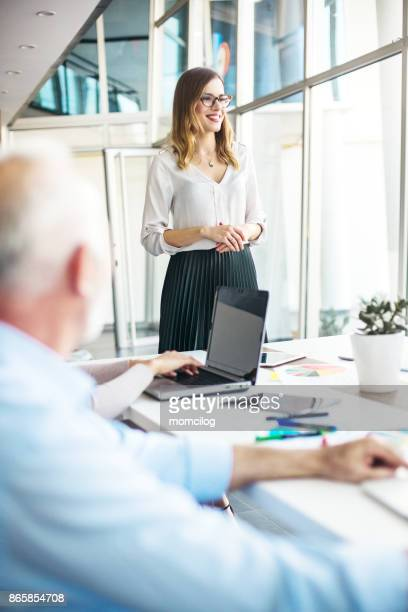 young businesswoman presenting plans for future - one young woman only stock pictures, royalty-free photos & images