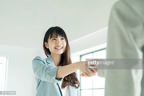 Young businesswoman shaking hand