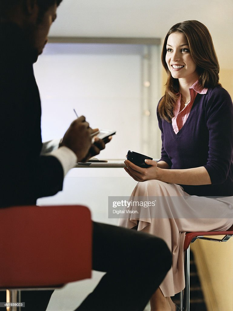 Young Businesswoman Sits at a Table Having a Coffee Break : Stock Photo
