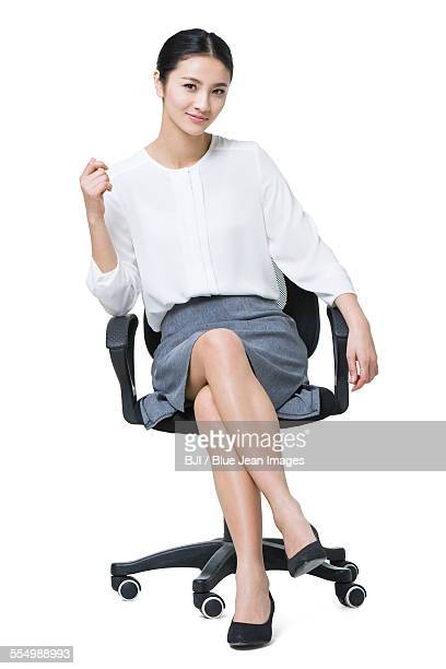 young businesswoman sitting on chair - 椅子 ストックフォトと画像