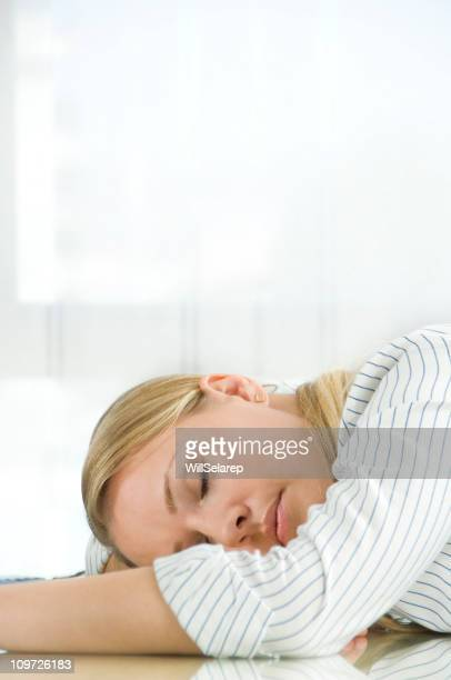 Young businesswoman sleeping on the desk