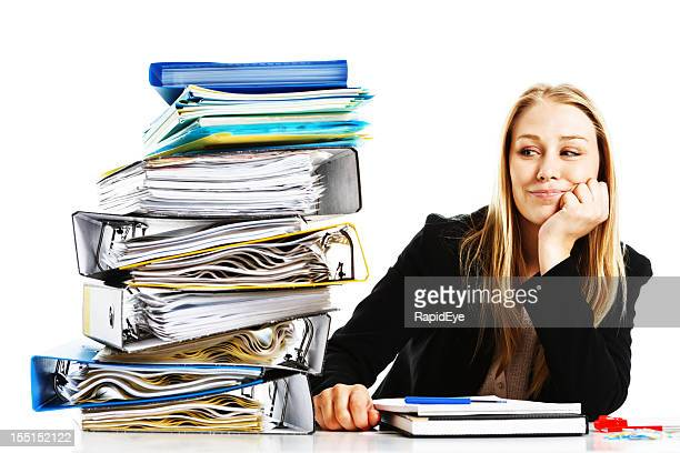 young businesswoman smiles confidently at her workload: she can cope - exceed and excel stock pictures, royalty-free photos & images