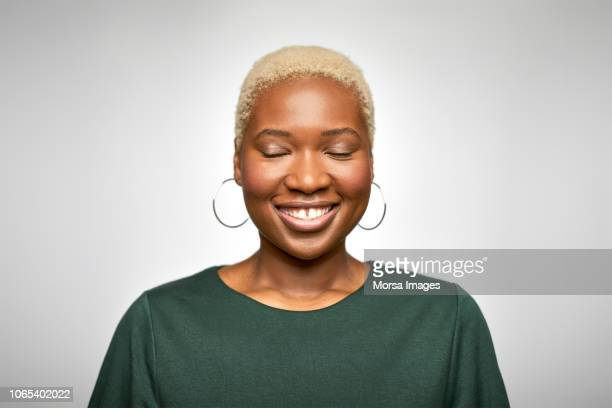 young businesswoman smiling with eyes closed - eyes closed stock pictures, royalty-free photos & images
