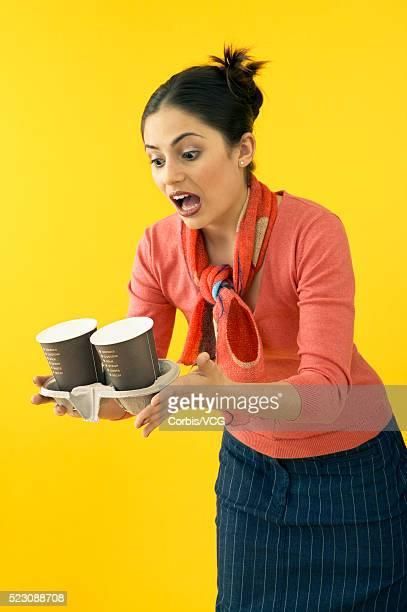 young businesswoman spilling coffee cups - careless stock pictures, royalty-free photos & images
