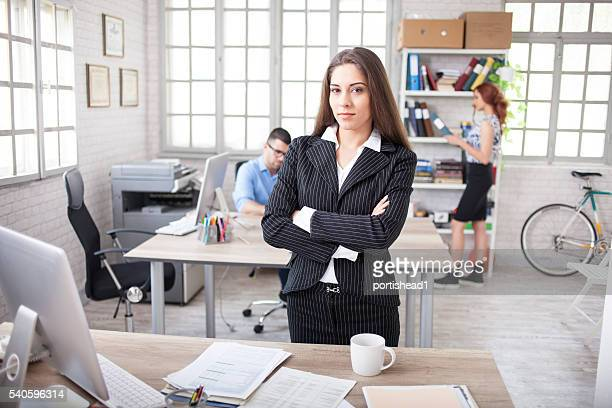Young businesswoman standing at workplace