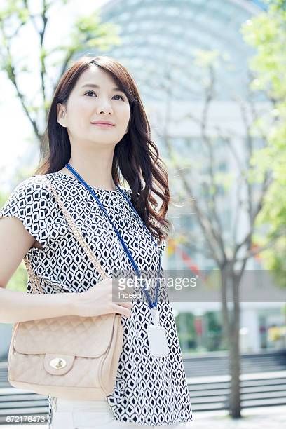 Young businesswoman standing on street