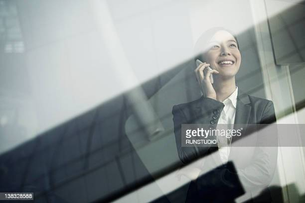 young businesswoman talking mobile phone