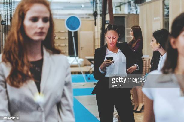 Young businesswoman text messaging in the office