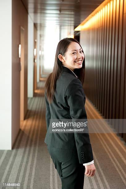 Young businesswoman turning, Tokyo Prefecture, Honshu, Japan