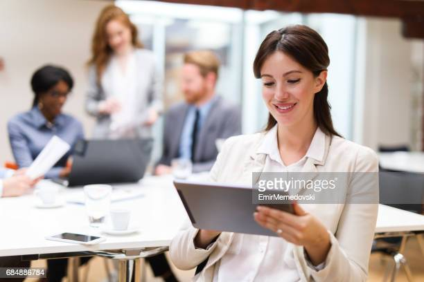 Young businesswoman using digital tablet in the office
