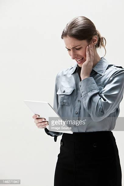 Young businesswoman using digital tablet, studio shot