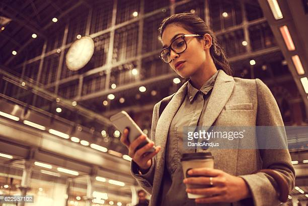 young businesswoman using her smartphone