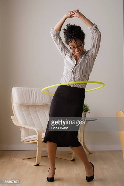 Young businesswoman using hoola hoop
