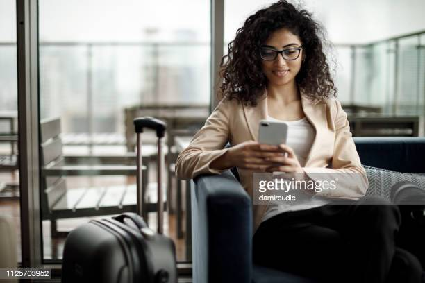 young businesswoman using mobile phone at a cafe - making a reservation stock photos and pictures
