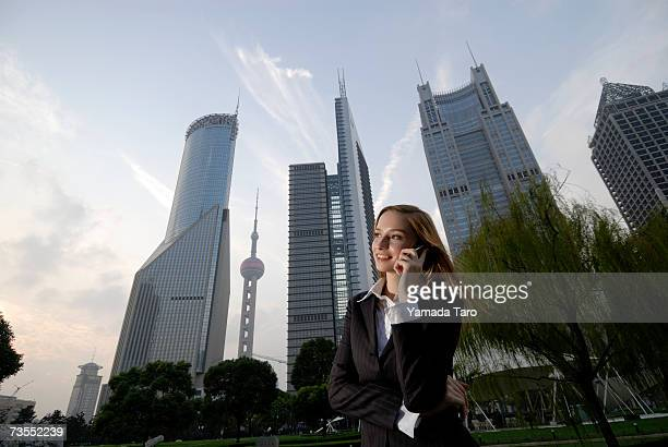 Young businesswoman using mobile phone in financial district