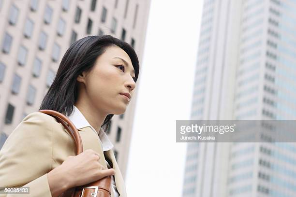 A young businesswoman walking